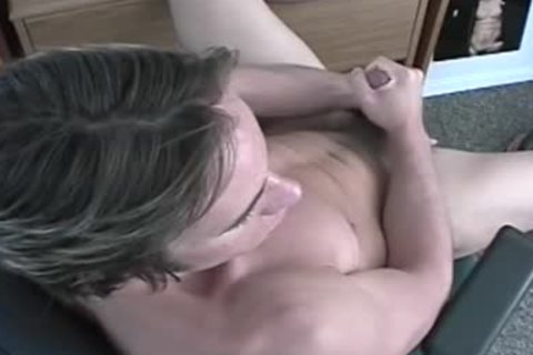 A lad Exposing His 10-Pounder And Pumping It
