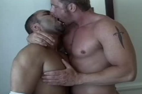 Tanned men enjoy An Intimate moment jointly