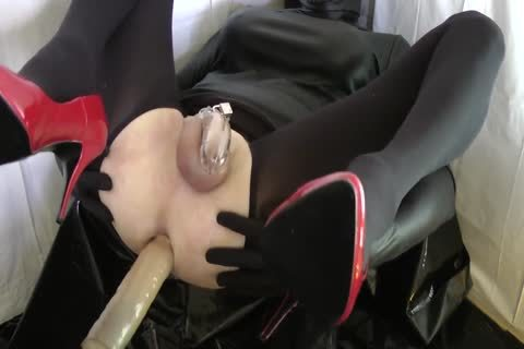Sissy With Red Heels Is nailed In A Chastity Belt